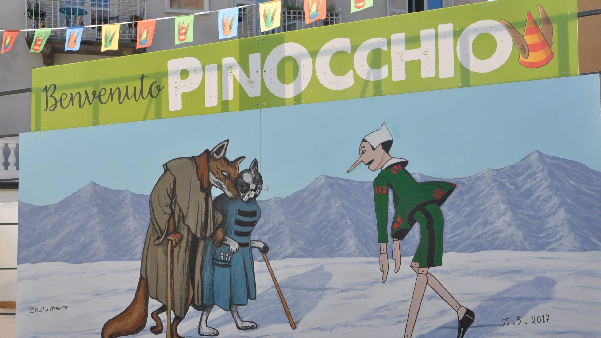 Il pittore Carlèt al lavoro con i murales su Pinocchio per Vivolibro 2017